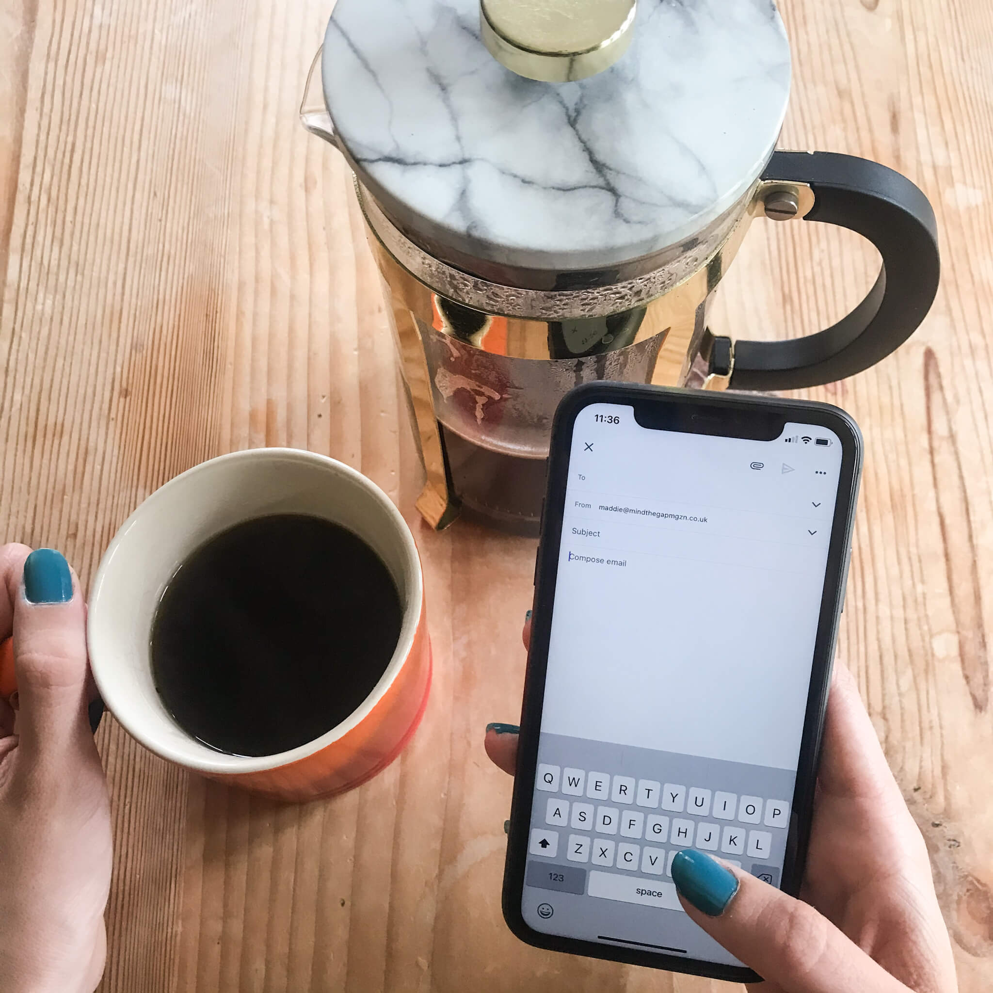 How to email at work | image showing coffee and holding a phone with an email open.