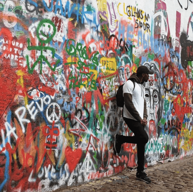 get the job you love | image shows young man stood in front of graffiti wall