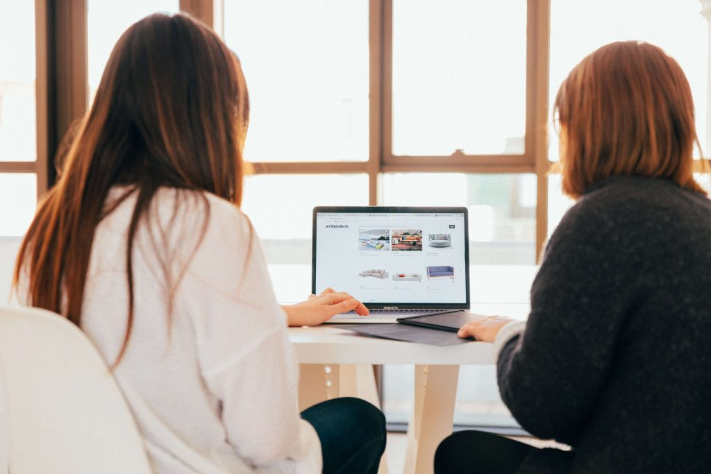 how to get the most out of mentorship - an image shows two women looking at a laptop
