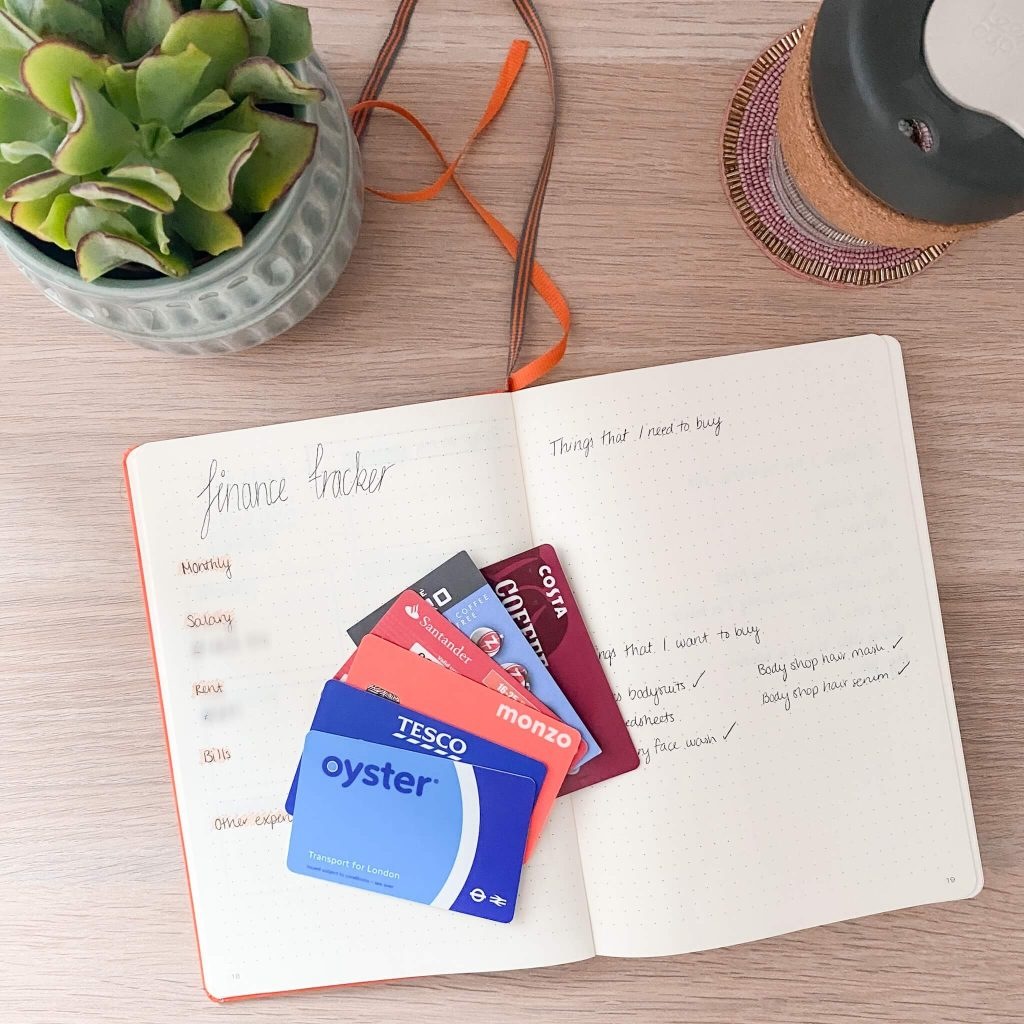 payday saveday | image shows a notebook with some loyalty cards spread out on