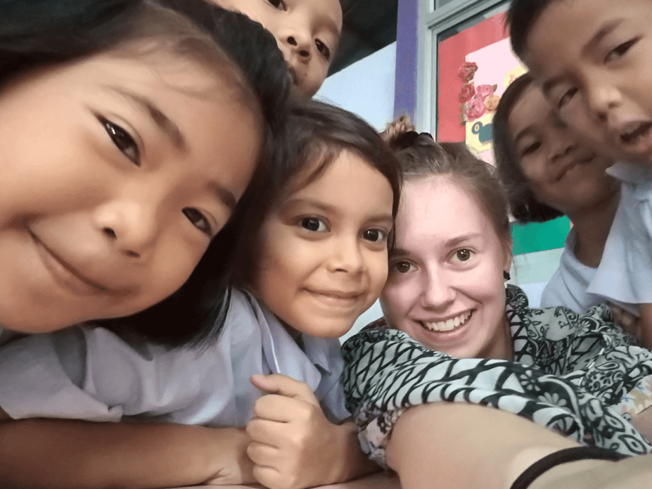Social anxiety and job interviews | image shows young woman with five children in a school classroom